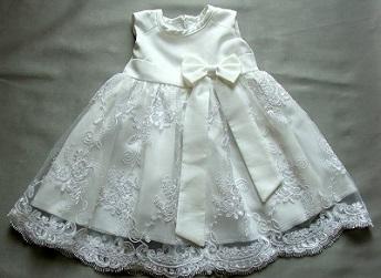 Sukienka do chrztu z kokardą bez rękawów na lato Abrakadabra rozmiar 62